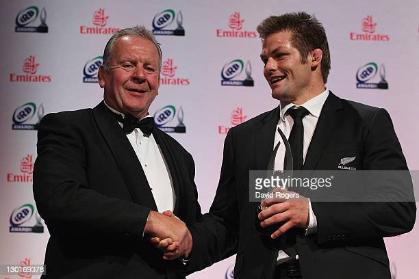 All Blacks captain Richie McCaw receives the IRB Team of the Year Award from IRB vice chairman Bill Beaumont during the 2011 IRB Awards ceremony at...