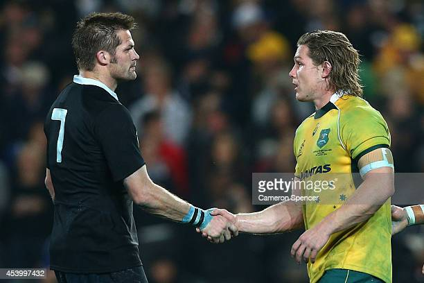All Blacks captain Richie McCaw shakes hands with Wallabies captain Michael Hooper after winning The Rugby Championship match between the New Zealand...