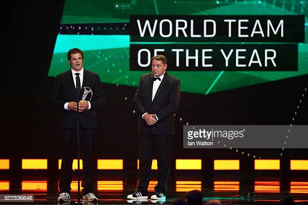 All Blacks Captain Richie McCaw speaks on stage with Steve Hansen, coach of the All Blacks looks on accepts the award on behalf of the All Blacks...