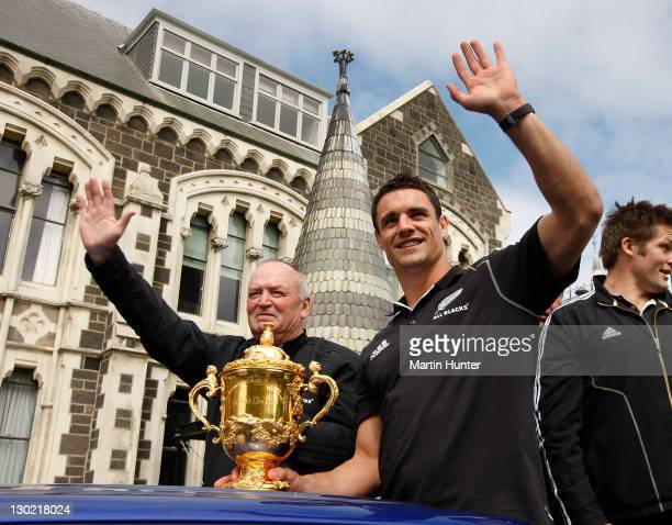 All Blacks coach Graham Henry and Dan Carter of the All Blacks wave to the crowd with the Webb Ellis Cup during the New Zealand All Blacks 2011 IRB...
