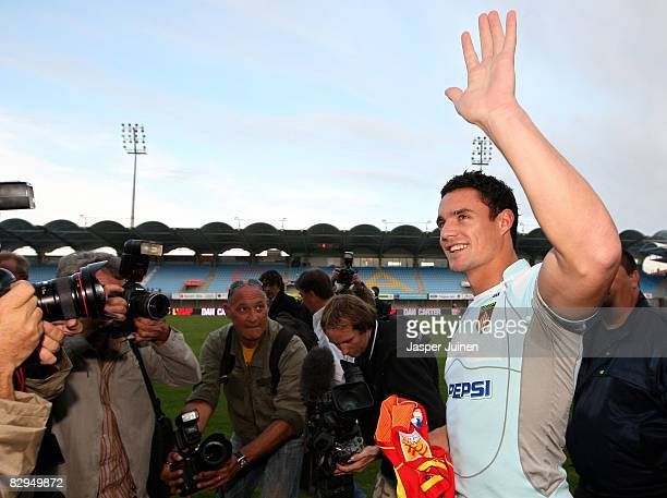 All Blacks Dan Carter of New Zealand is surrounded by the press during his presentation at the Aime Giral Stadium on September 22 2008 in Perpignan...