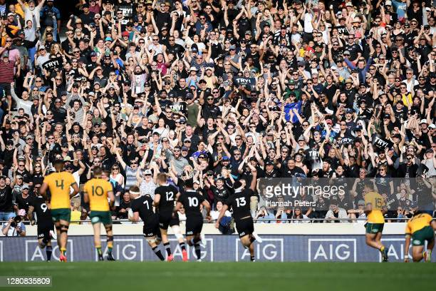All Blacks fans cheer Sam Cane of the All Blacks as he scores a try during the Bledisloe Cup match between the New Zealand All Blacks and the...