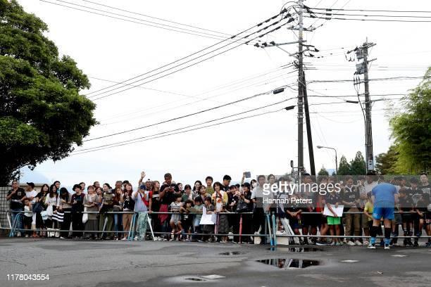 All Blacks fans wait outside a New Zealand training session at Jissoji Tamokuteki Ground on September 30, 2019 in Beppu, Oita, Japan.