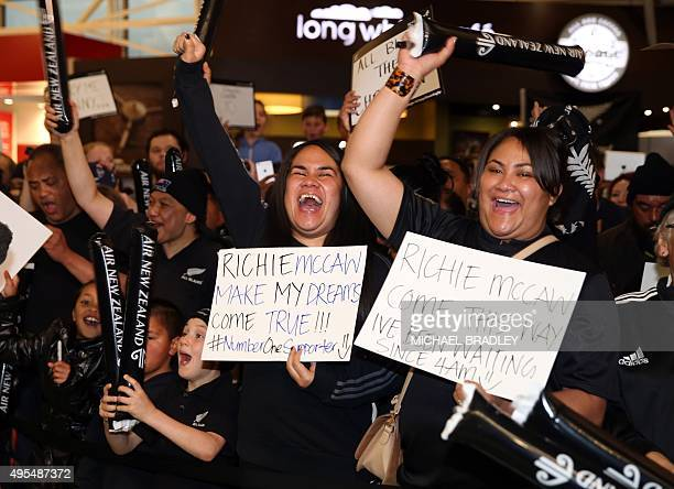 All Blacks fans welcome home the team after they arrived back home with the Rugby World Cup trophy at the Auckland Airport in Auckland on November 04...