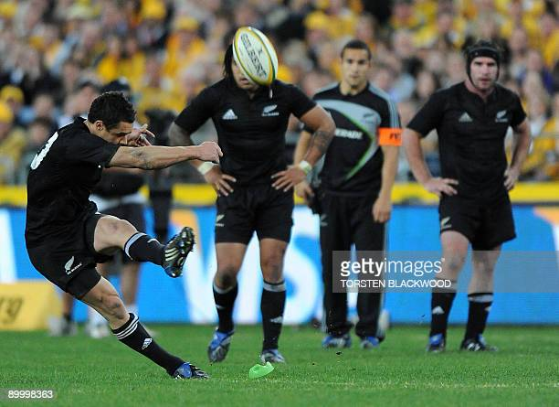 All Blacks five-eighth Dan Carter kicks the winning penalty shot at the Wallaby goal during the Tri-Nations Bledisloe Cup rugby union test match...