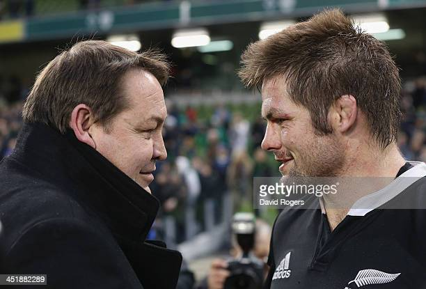 All Blacks head coach Steve Hansen and Richie McCaw the captain celebrate after their narrow victory during the International match between Ireland...