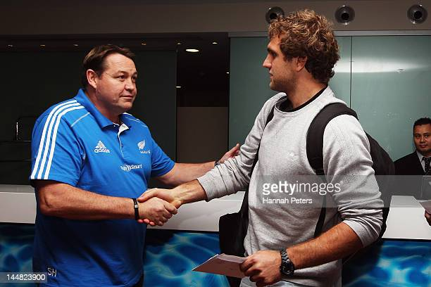 All Blacks head coach Steve Hansen shakes hands with Luke Whitelock following a New Zealand All Blacks press conference at on May 20 2012 in Auckland...