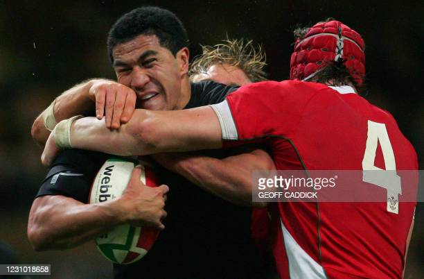 All Blacks' Jerome Kaino is tackled by Wales' Andy Powell and Alun-Wyn Jones during their Invesco Challenge rugby union internatonal match Wales vs....