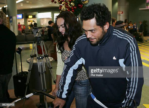 All Blacks John Afoa arrives home from the All Black's end of year tour to the UK at the Auckland International Airport on November 29 2005 in...