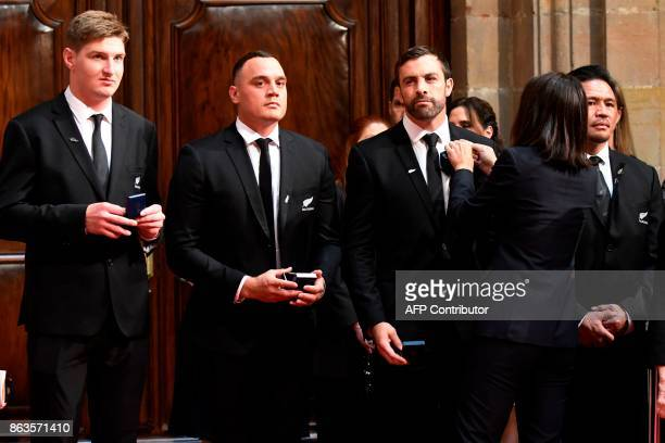 'All Blacks' New Zealand national rugby union team players Conrad Smith Jordie Barrett Israel Dagg and Keven Mealamu receive a medal during an...