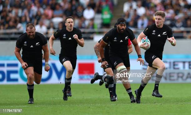 All Blacks player Jordie Barrett makes a break with team mates in support during the Rugby World Cup 2019 Group B game between New Zealand and...