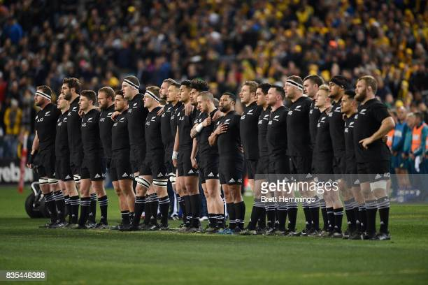 All Blacks players stand for the anthem during The Rugby Championship Bledisloe Cup match between the Australian Wallabies and the New Zealand All...