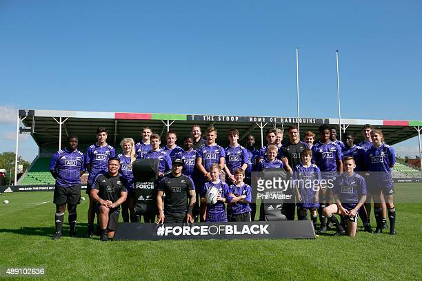 All Blacks pose with young rugby players during an adidas Force of Black event at Twickenham Stoop on September 19, 2015 in London, England. The day...