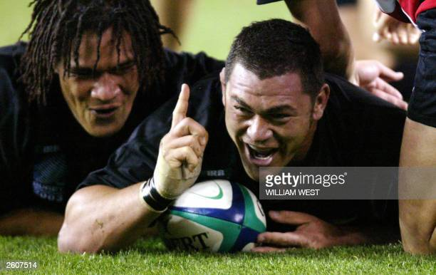 All Blacks prop Kees Meeuws celebrates scoring a try with teammate, number eight Rodney So'oialo in their Rugby World Cup pool D match between New...