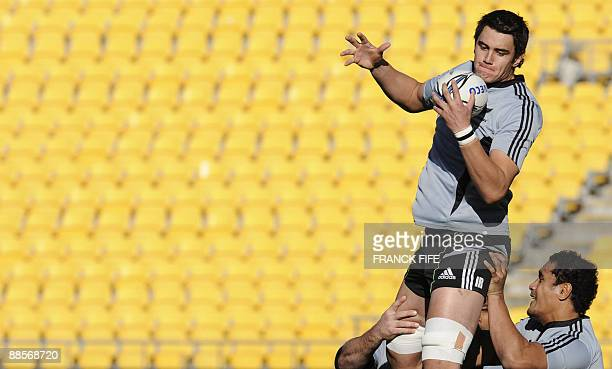 All Blacks rugby player Isaac Ross grabs the ball in a lineout in front Jerome Kaino during a training session at the Westpac Stadium in Wellington...