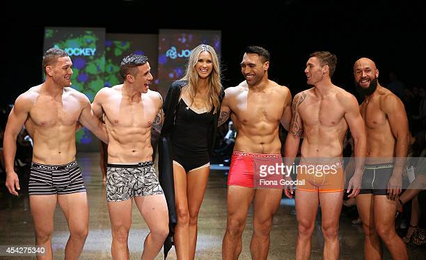 All Blacks rugby players Tawera KerrBarlow TJ Perenara Nikki Philips Victor Vito Gillies Kaka and DJ Forbes showcase designs by Jockey in the Resene...