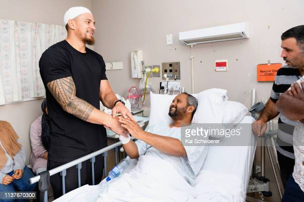 All Blacks Rugby Star Sonny Bill Williams speaks to Ziyaad Shah, a survivor of the shootings at Al Noor mosque, during a visit to Christchurch...