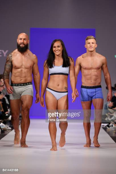 All Blacks Sevens player DJ Forbes All Black Damien McKenzie with Black Fern Portia Woodman showcasing designs by Jockey on the runway at New Zealand...