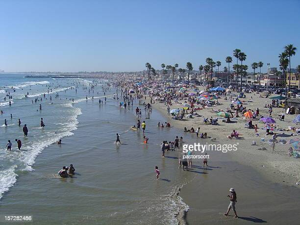 all busy beach - orange county crowded beaches stock pictures, royalty-free photos & images