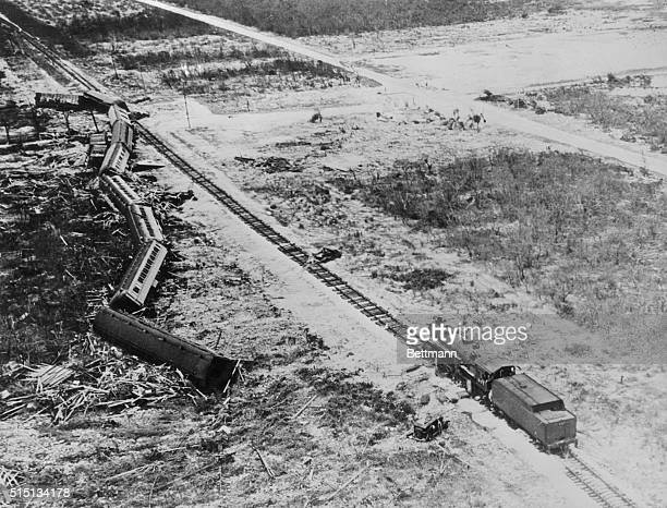 All but the engine of this Florida East Coast Emergency Relief train was blown from the tracks by the hurricane just below Snake Creek near...