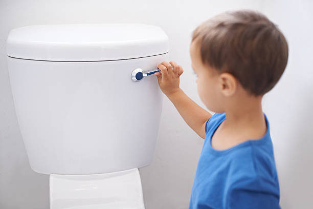 all done! -  child using toilet stock pictures, royalty-free photos & images