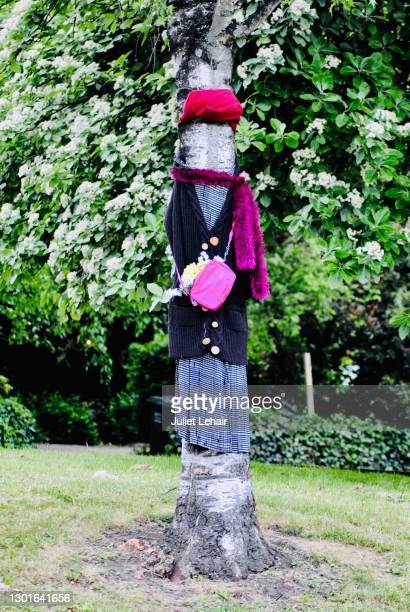 """""""all dressed up"""" in the park gardens. - pink purse stock pictures, royalty-free photos & images"""