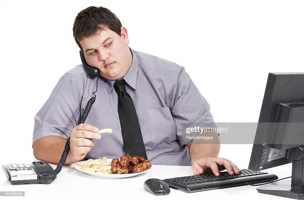 All eating and no exercise : Stock Photo