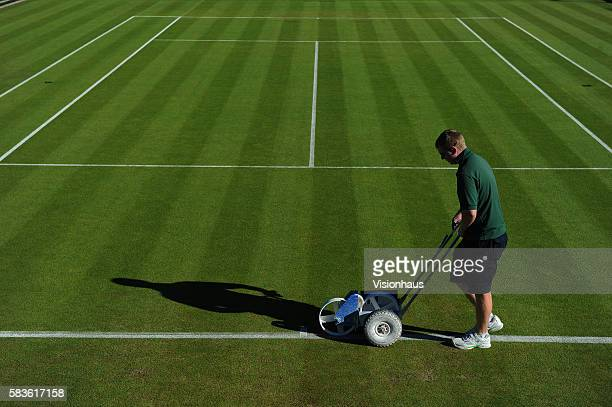 All England Club ground staff prepare one of the grass courts for the start of play on Day Two of the 2015 Wimbledon Lawn Tennis Championships at the...