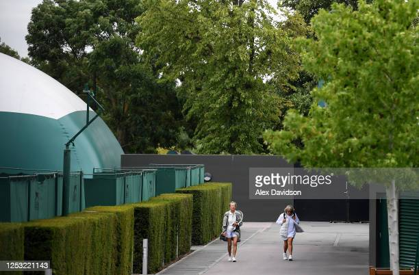 All England Tennis and Croquet Club members walk to a court on June 29 2020 in Wimbledon England The Wimbledon Tennis Championships were due to start...