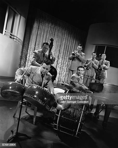 All eyes are on Johnny Williams as he wields a wicked drumstick for the desired effect in War Dance for Wooden Indians which the Raymond Scott...