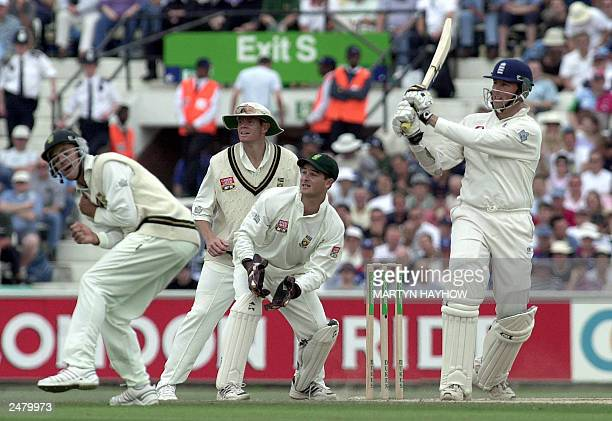 All eyes follow England's Marcus Trescothick shot as he scores another four runs to bring up his fourth Test century 06 September 2003 on the third...