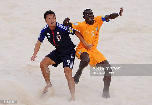 All eyes on the ball for Takeshi Kawaharazuka of Japan and Lacine Diamonde of Ivory Coast during the FIFA Beach Soccer World Cup Tahiti 2013 Group D...