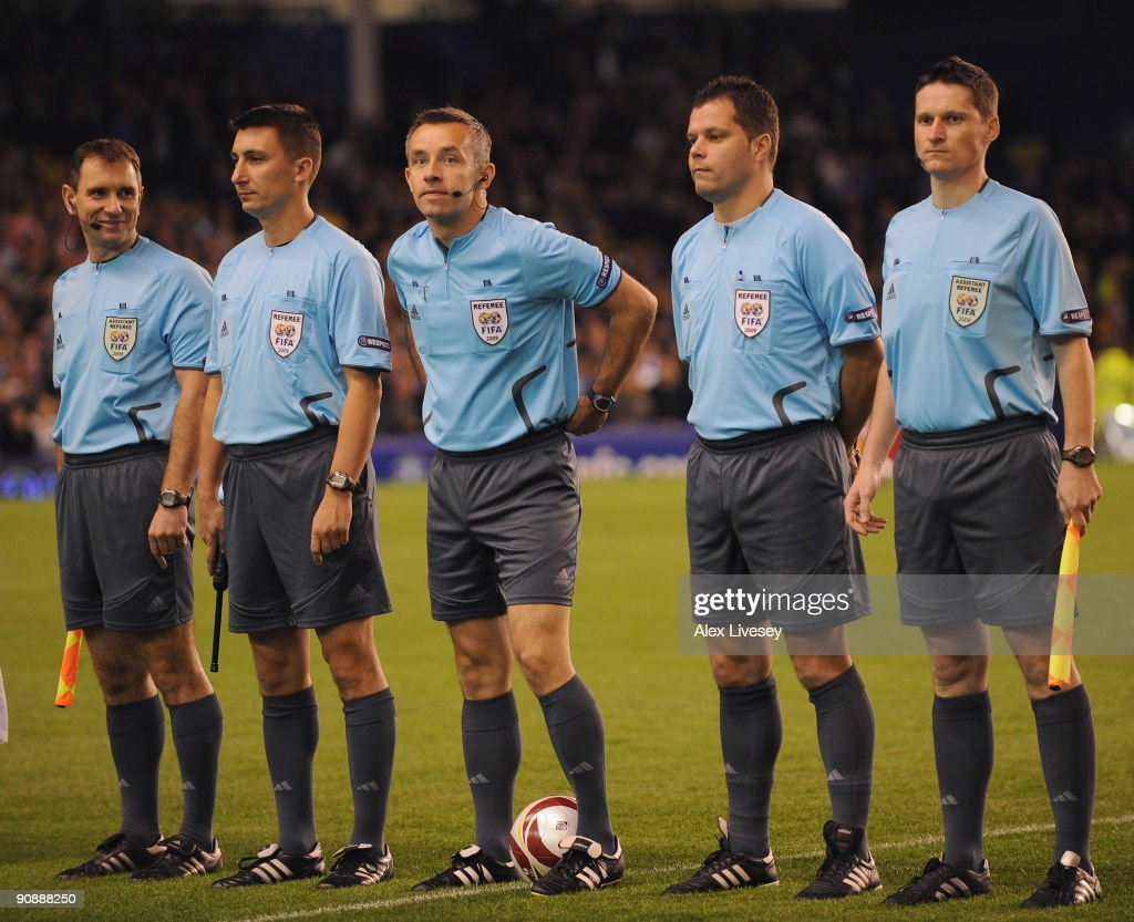 All five officials line up prior to the UEFA Europa League Group I match between Everton and AEK Athens at Goodison Park on September 17, 2009 in Liverpool, England.