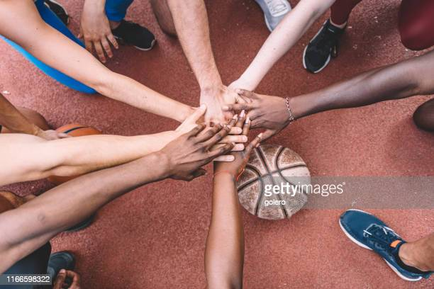 all for one - huddling stock pictures, royalty-free photos & images