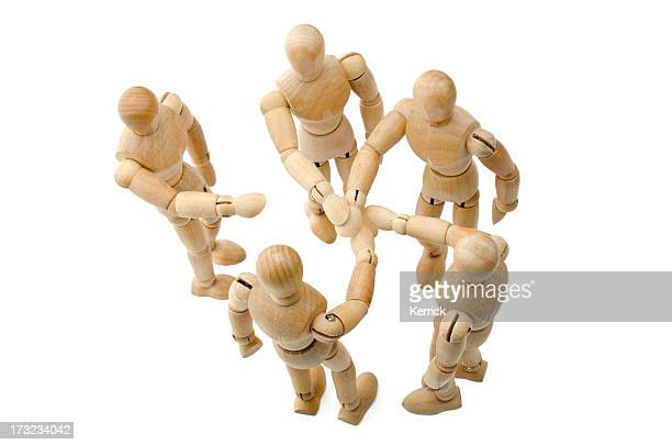 all for one - Wooden mannequin putting hands together