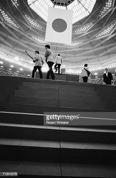All four Beatles arrive on stage at Tokyos Budokan Hall Japan 2nd July 1966
