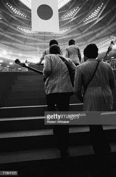 All four Beatles arrive on stage at Tokyo's Budokan Hall Japan, 2nd July 1966.