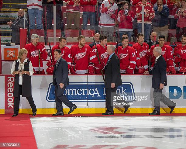 All four of former Detroit Red Wing Gordie Howe's children Cathy, Murray, Marty and Mark Howe walk out to center ice for the ceremonial puck drop in...