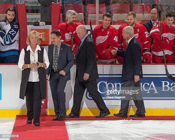 All four of former Detroit Red Wing Gordie Howe's children Cathy Murray Marty and Mark Howe walk out to center ice for the ceremonial puck drop in...