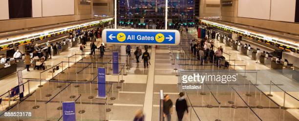 all gates sign at the airport with people checking-in - lax airport stock pictures, royalty-free photos & images