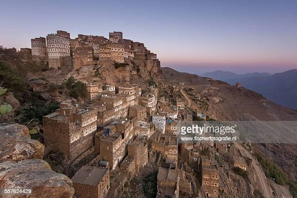 all hajjara rock village at dawn - sanaa photos et images de collection