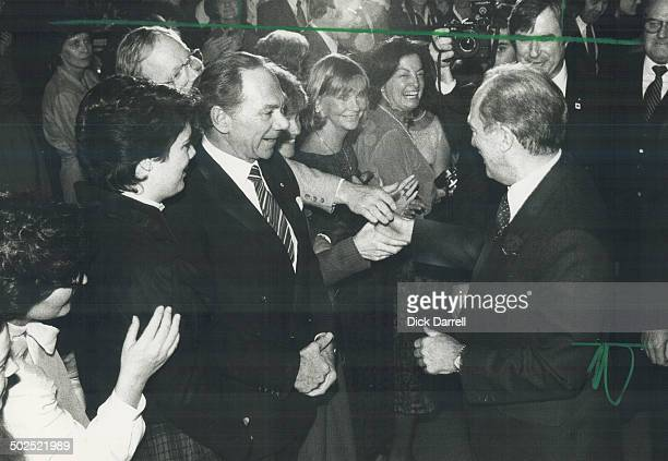 All hands on deck Murray Koffler chairman of Shoppers Drug Mart has received his handshake from Prime Minister Pierre Trudeau but other dinner guests...