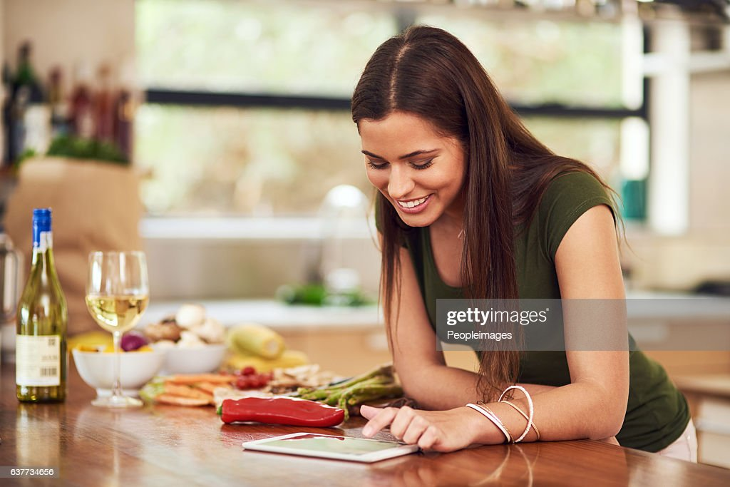 All her recipes on one device : Stock Photo