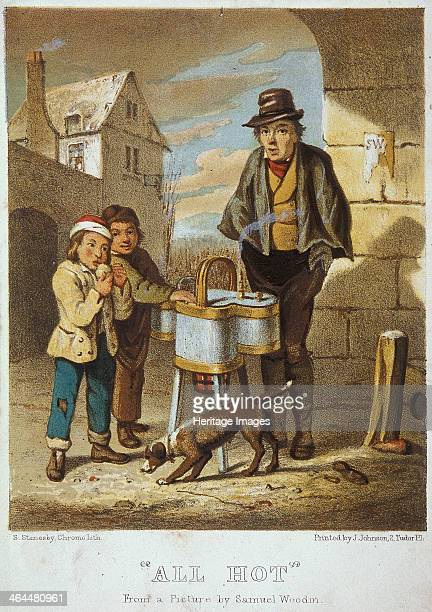 'All Hot'. A baked potato seller with two boys. Standing on a street corner, one of the boys is eating a baked potato, while a dog stands in front of...