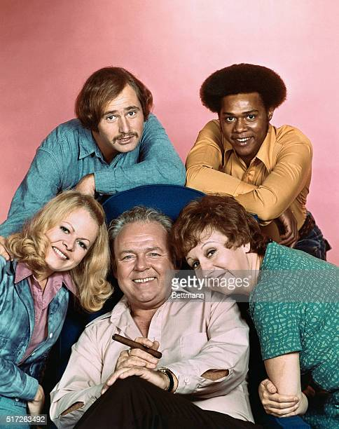 All in the Family cast: Carroll O'Connor , Sally Struthers , Rob Reiner , Mike Evans and Jean Stapleton.