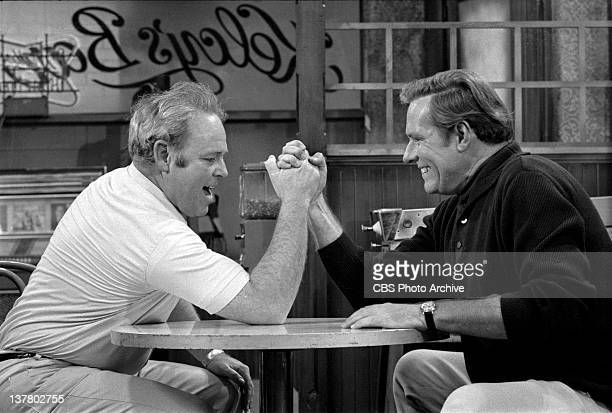 All In The Family episode: 'Judging Books by Covers', featuring Carroll O'Connor as Archie Bunker arm wrestling Philip Carey as Steve, an...