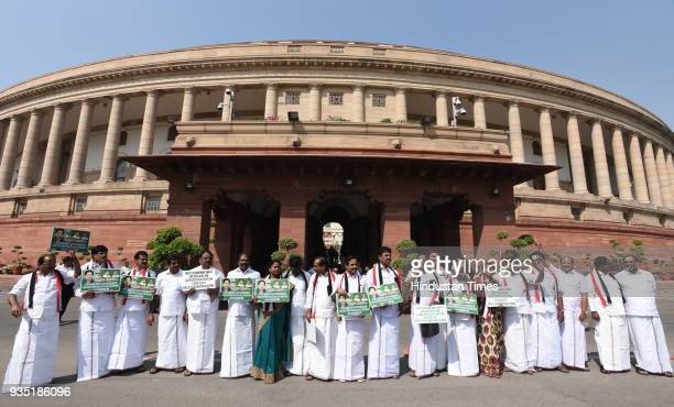 All India Anna Dravida Munnetra Kazhagam leaders raise slogans demanding constitution for Cauvery Management Board during the Parliament Budget...