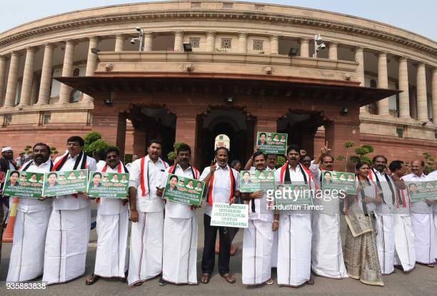 All India Anna Dravida Munnetra Kazhagam leaders raise slogans demanding constitution for Cauvery Management Board during the Budget Session of...