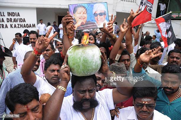 All India Anna Dravida Munnetra Kazhagam party cadres celebrate after party chief Jayalalithaa Jayaram was cleared of corruption charges by Karnataka...