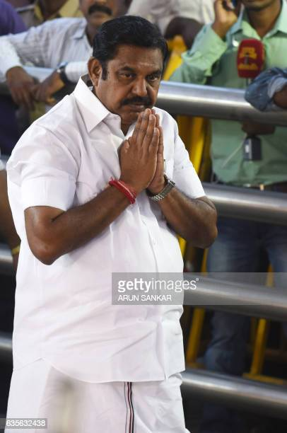 All India Anna Dravida Munnetra Kazhagam party leader Edappadi Palanisamy gestures as he pays his respects at the memorial for former state chief...